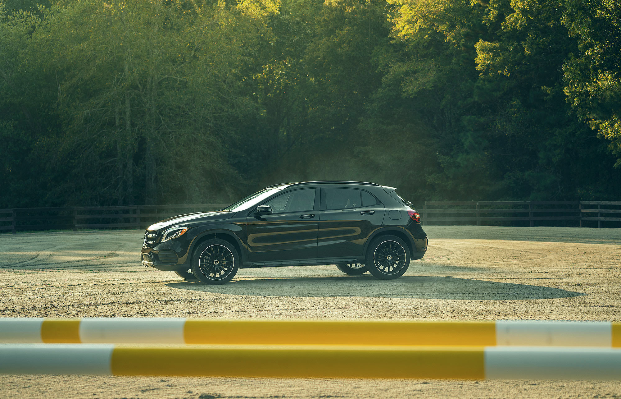 Mercedes-Benz GLA SUV in horse riding arena