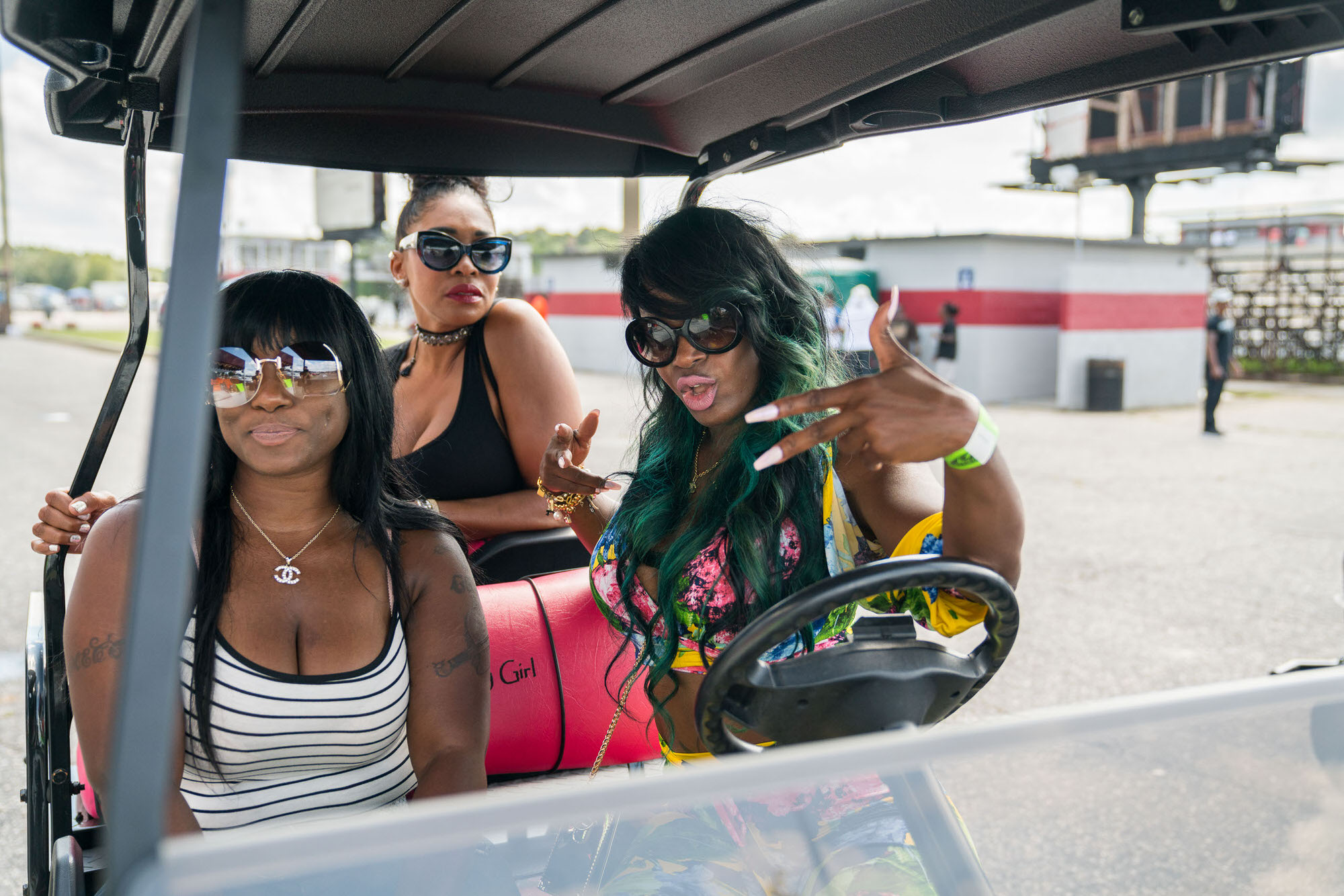 Golf Kart ladies at Fast & Flashy DONK event at Darlington Dragway