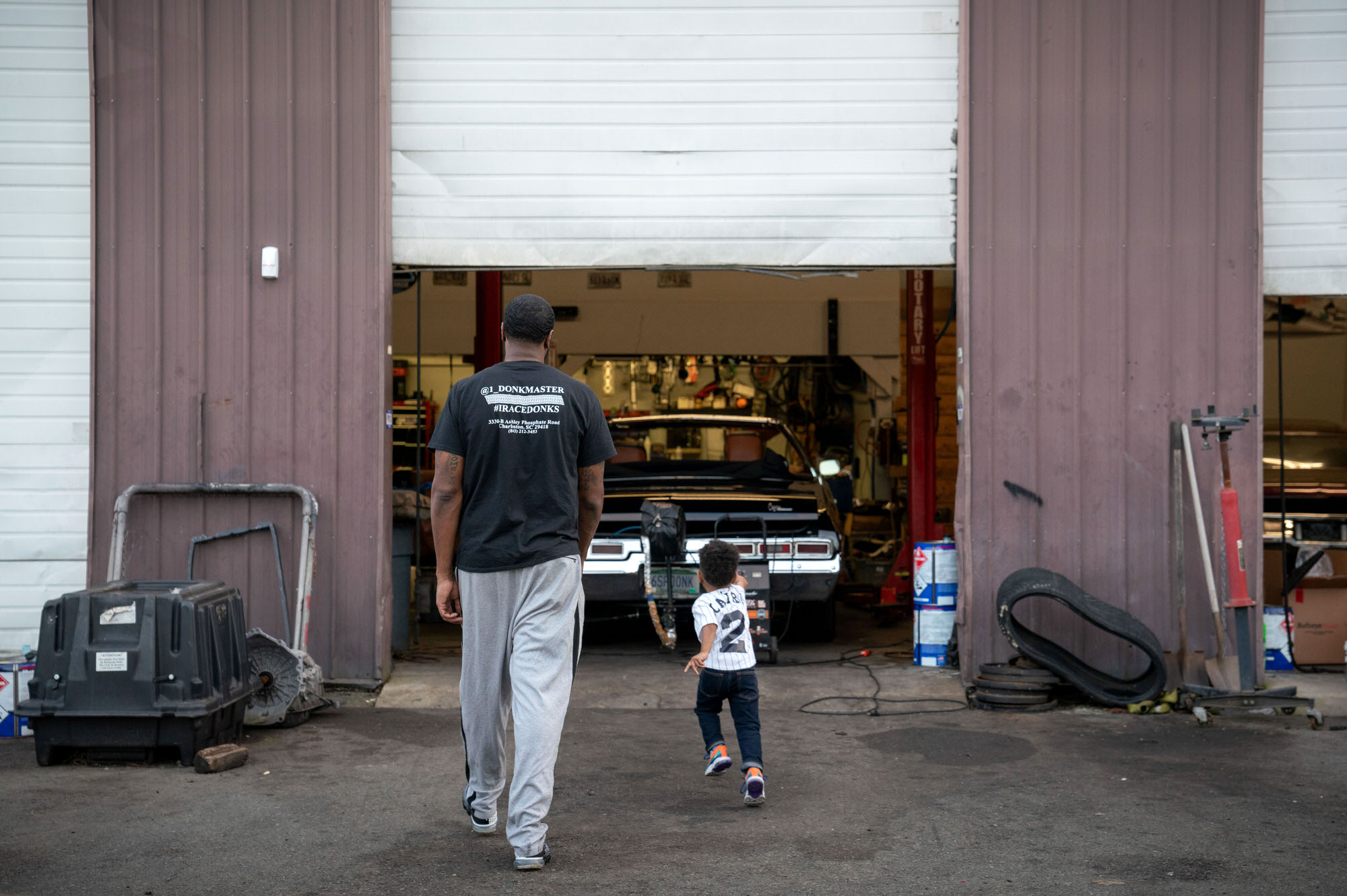Donkmaster and son at his shop In and Out Customs