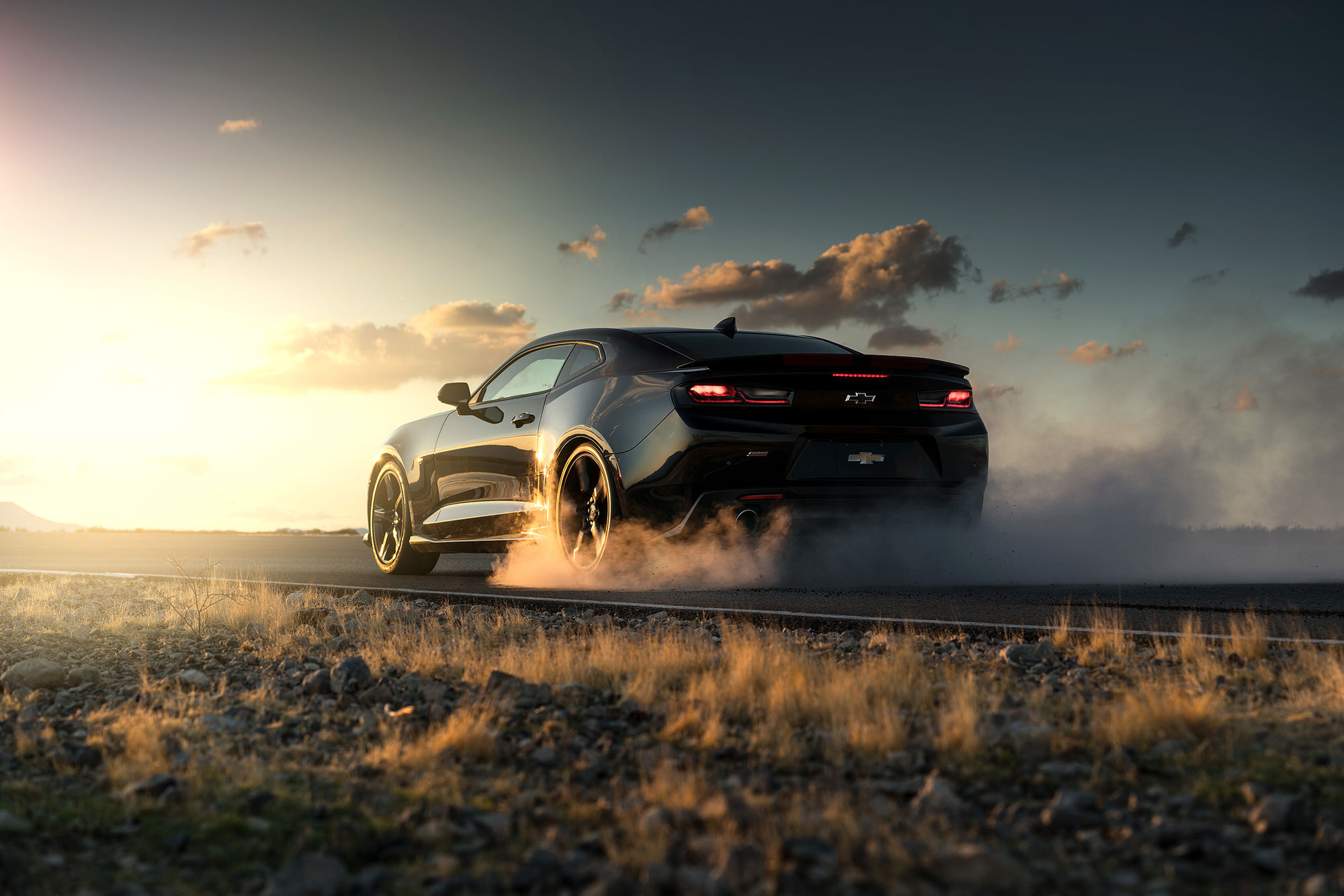 Burnout in the desert of Nevada in a black Chevrolet Camaro SS.