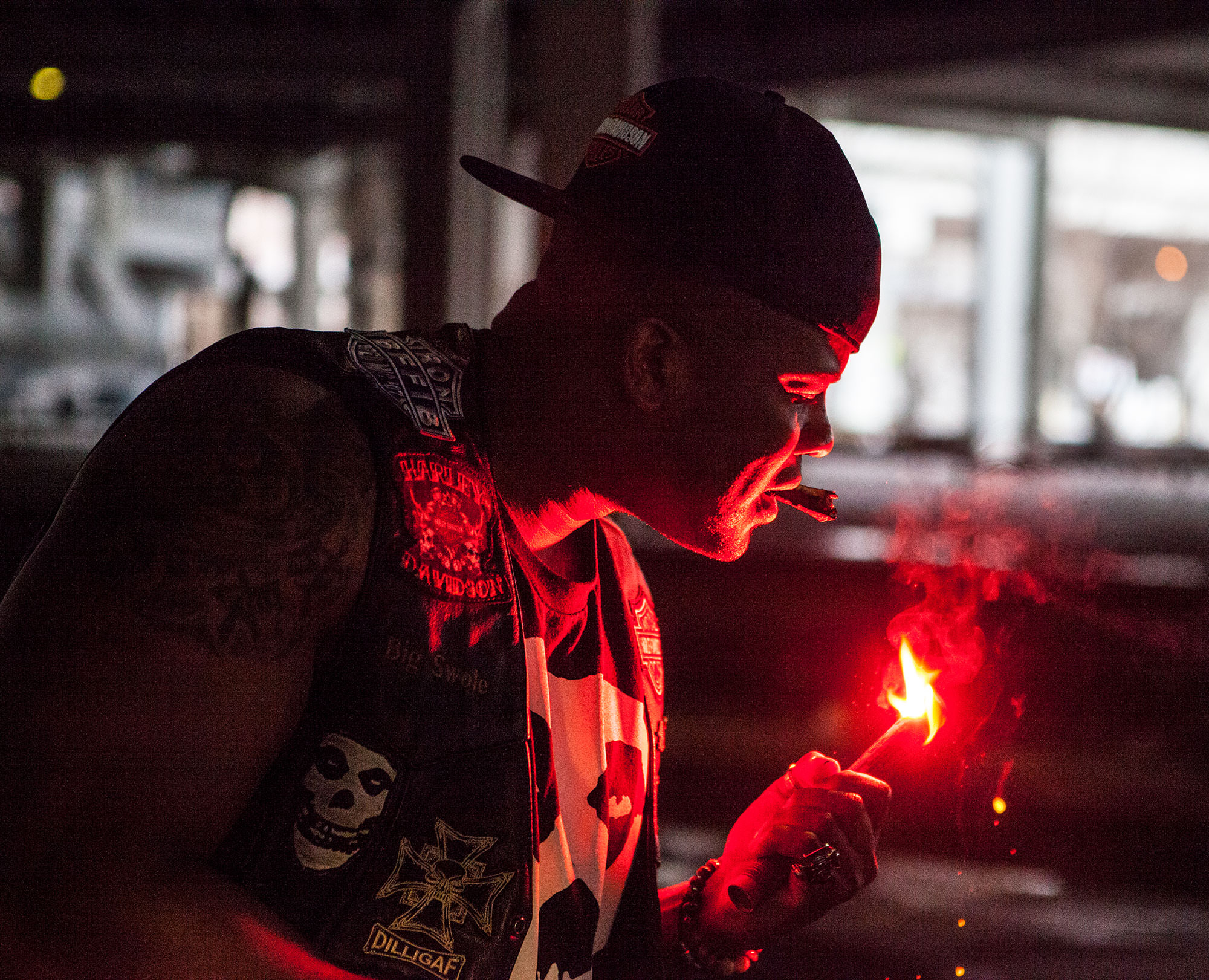 Big Swole lighting up his cigar during a Harley-Davidson photoshoot.