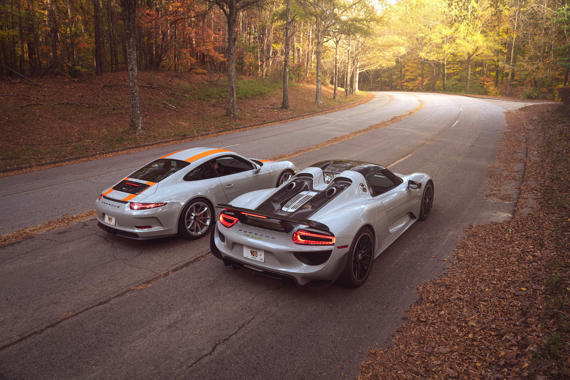 911 R vs. 918. Normally aspirated 500hp vs. hybrid 887hp. Manual 6-speed vs. PDK 7-speed.