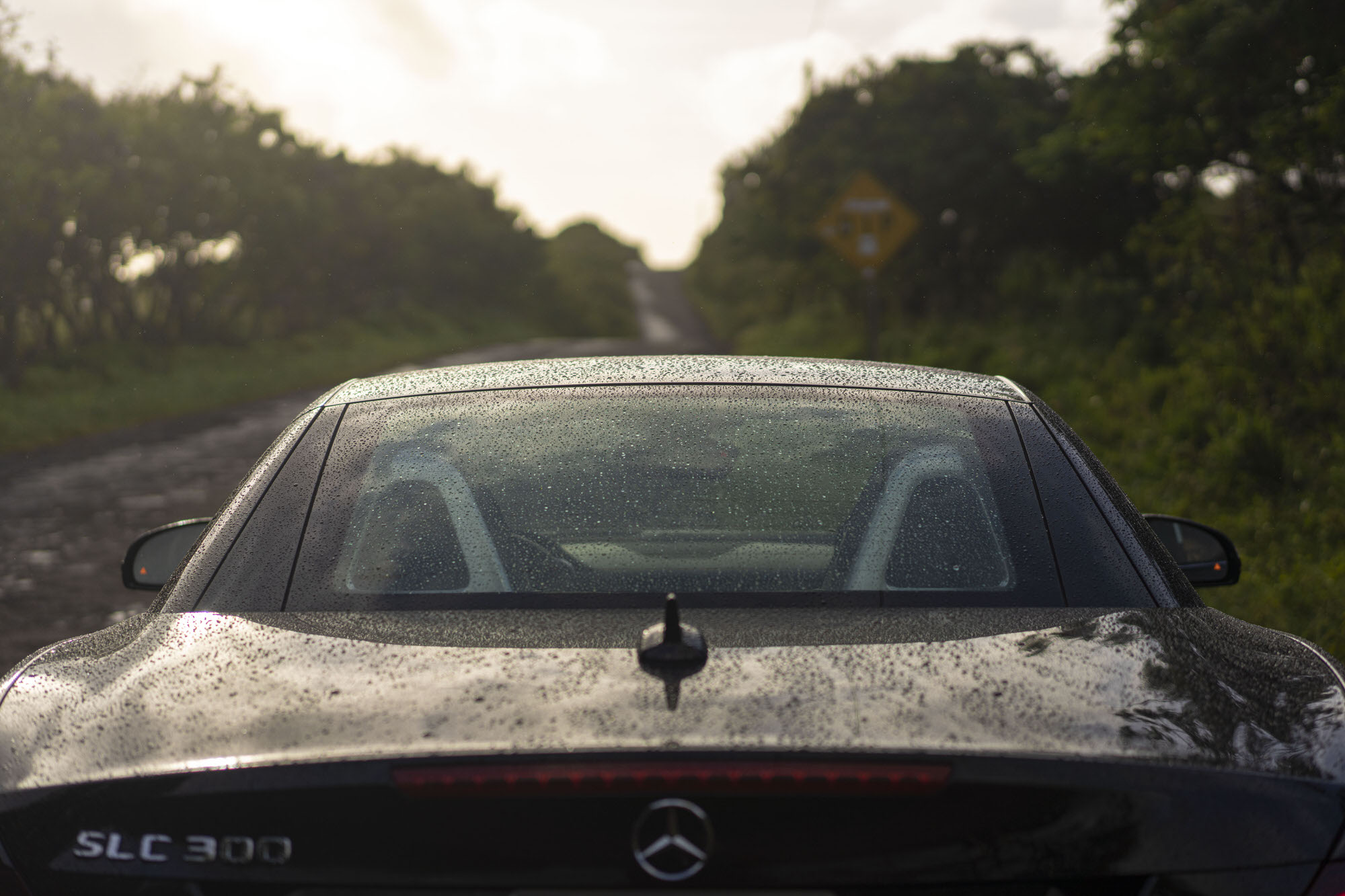 Raindrops on a black Mercedes-Benz SLC 300 in Maui, Hawaii