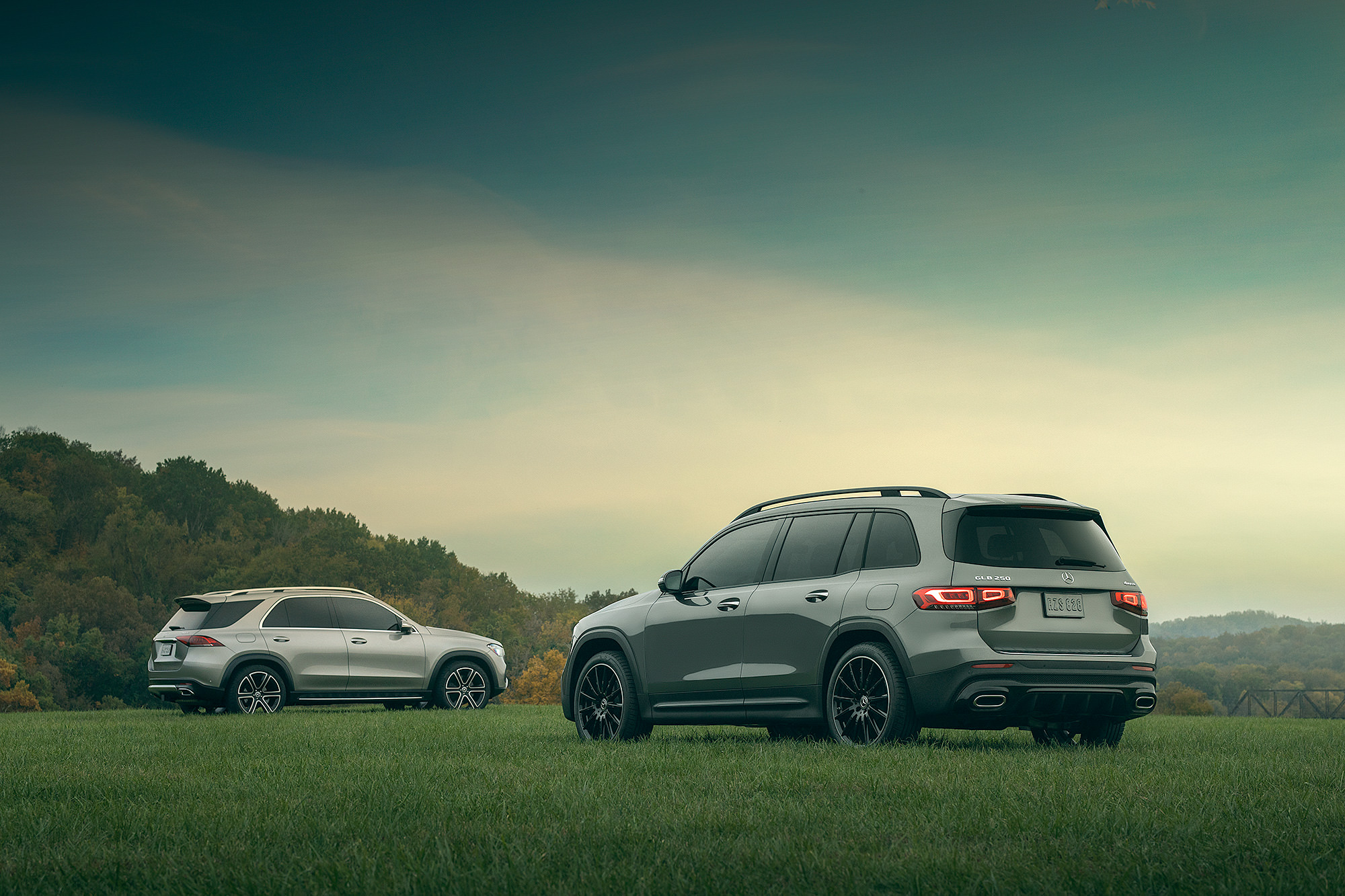 Two Mercedes-Benz SUV sunset