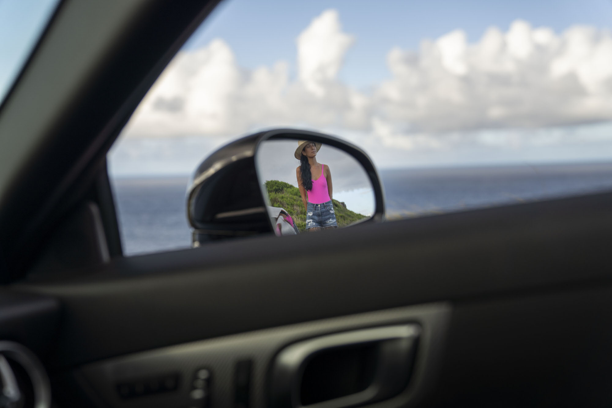 Chelsea Zerjav in the rear mirror of a Mercedes-Benz SLC 300