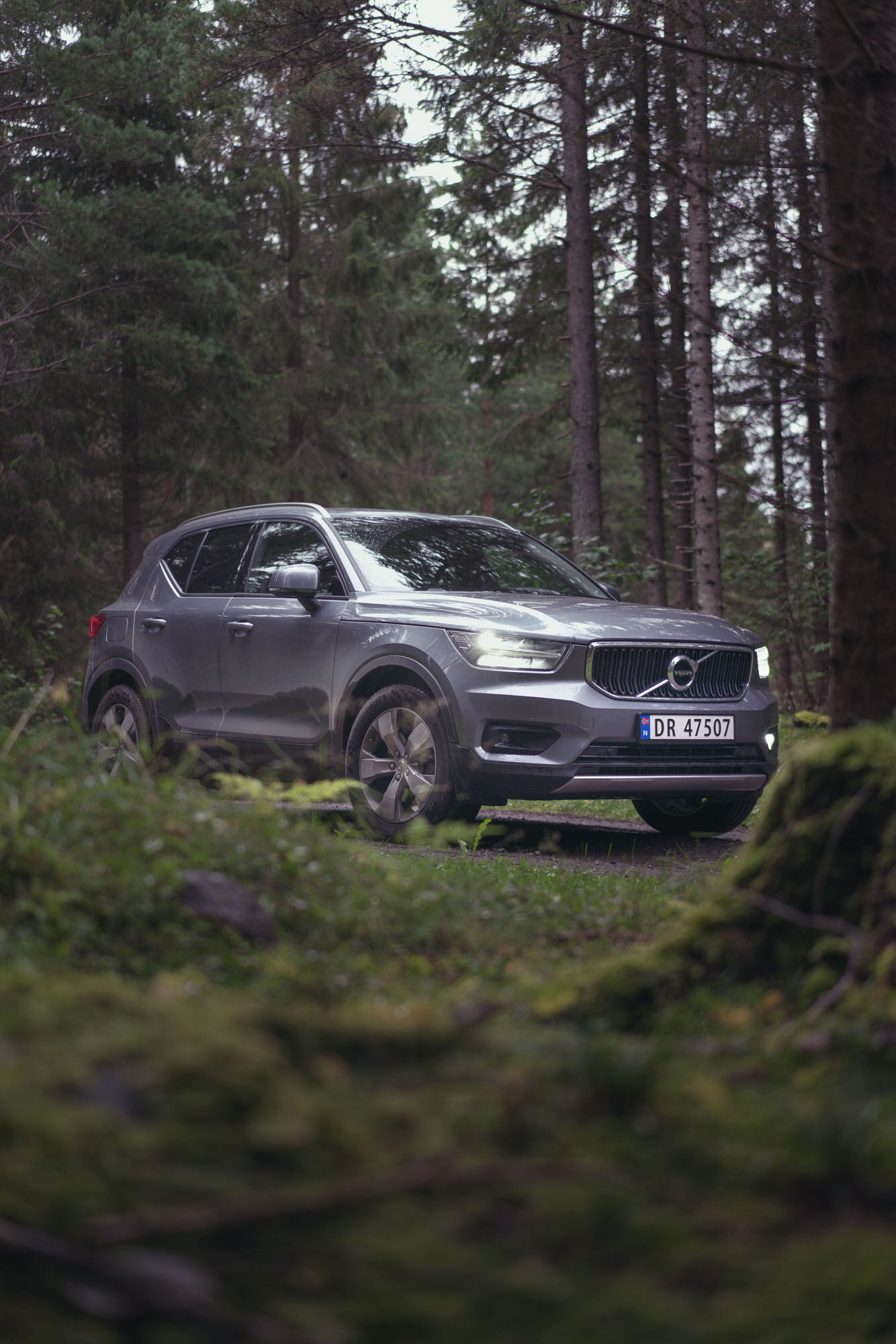 Silver Volvo XC40 in the deep forest of Hamar, Norway