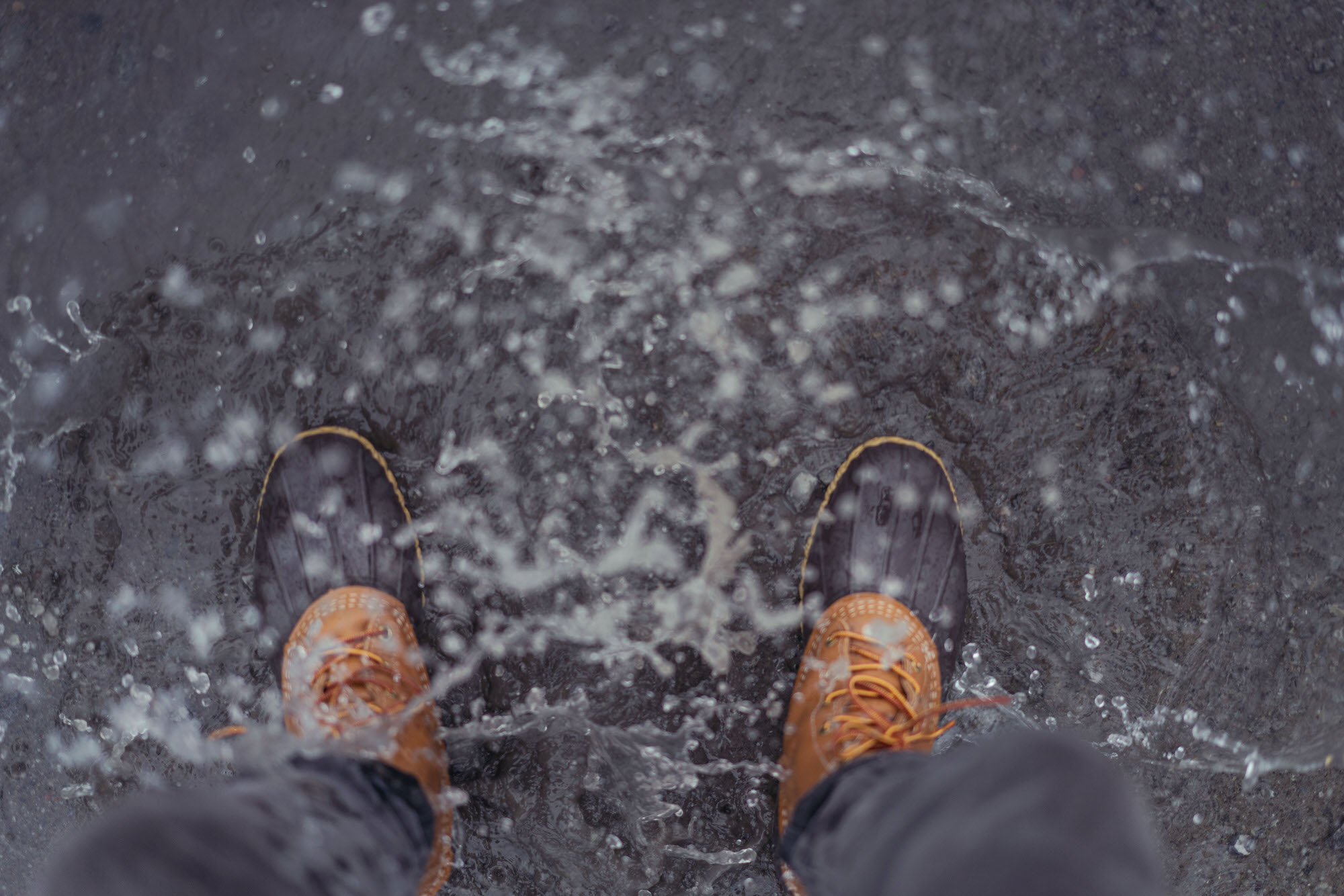 LL Bean Boots splashing in water in Hamar, Norway