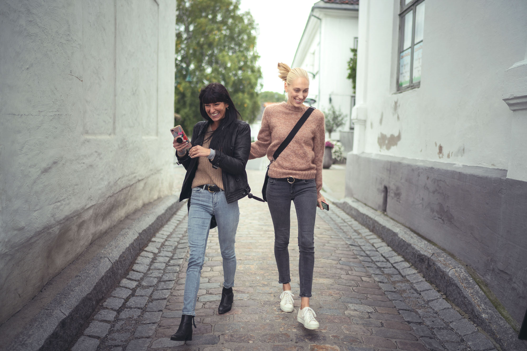 Best Friends Chelsea and Andrea walking down the streets of Son, Norway