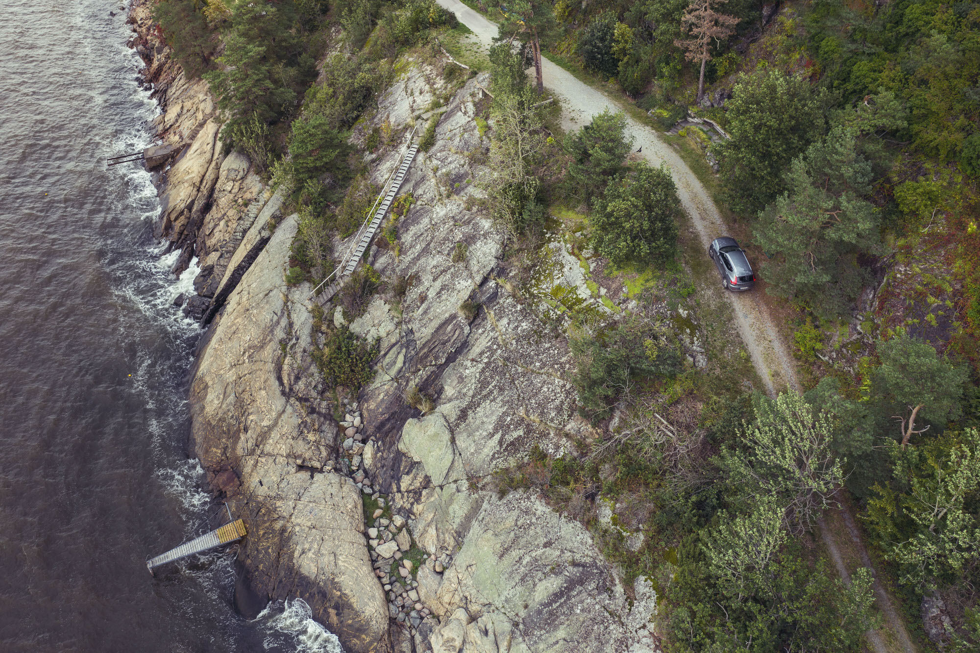 Aerial photography of Volvo XC40 driving the coastline of Son, Norway